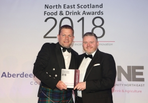James receives award from Jason Robertson, National Trust for Scotland